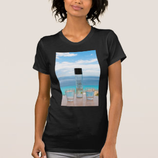 Cool water filled bottle and glasses t shirt