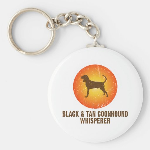 Coonhound negro y del moreno llavero redondo tipo pin