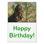 Coonhound negro y del moreno tarjeta de felicitación