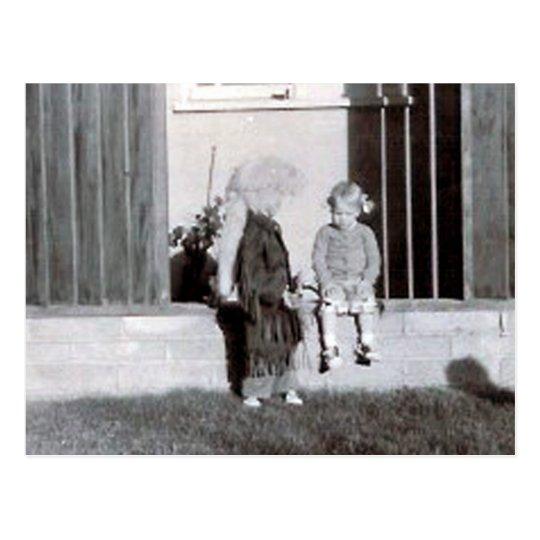 coonskin kid and girl postcard