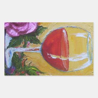 Copa de vino roja y pegatina color de rosa rosado