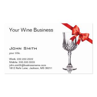 Copa de vino y tarjeta de visita roja de la cinta