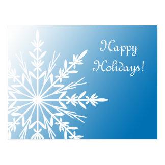 Copo de nieve blanco en la postal azul del día de