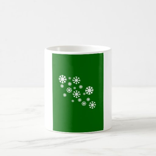 Copo de nieve con el fondo verde taza