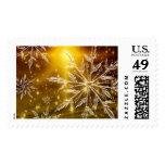 Copo de nieve de oro del navidad sello postal