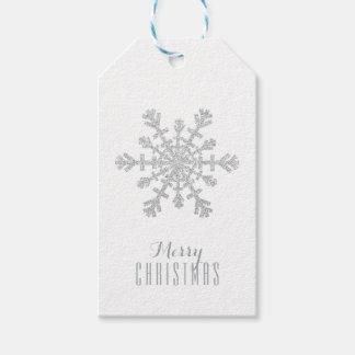 Copo de nieve de plata del navidad y brillo y etiquetas para regalos