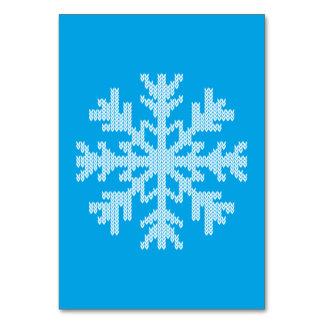 Copo de nieve de punto del blanco en azul de cielo