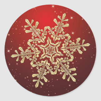 Copo de nieve del oro en el pegatina rojo del