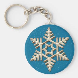 Copo de nieve del oro en llavero azul del día de f
