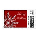 Copo de nieve en sello del rojo buenas fiestas
