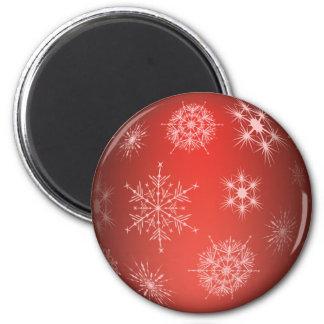 Copo de nieve rojo del navidad imán redondo 5 cm