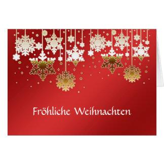 Copos de nieve alemanes del navidad en rojo tarjeta de felicitación