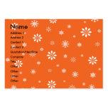 Copos de nieve anaranjados y blancos tarjetas de visita