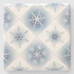Copos de nieve azules brillantes posavasos de piedra