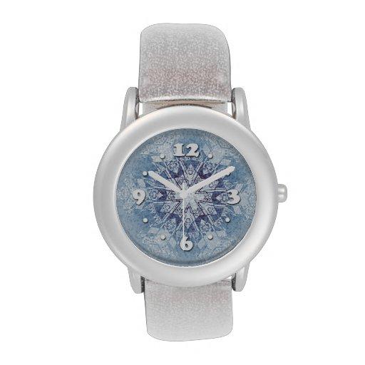 Copos de nieve azules brillantes reloj