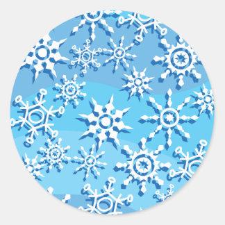 Copos de nieve azules de la onda pegatina redonda