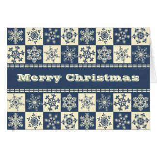 Copos de nieve azules de las Felices Navidad y pon