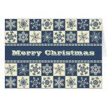 Copos de nieve azules de las Felices Navidad y Tarjeton