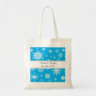 Copos de nieve azules que casan favores bolsas lienzo