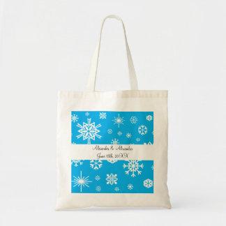 Copos de nieve azules que casan favores bolsas de mano