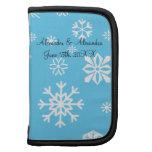Copos de nieve azules que casan favores planificador
