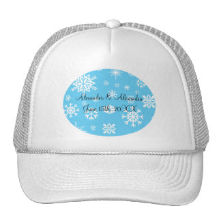 Copos de nieve azules que casan favores gorros