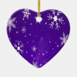 Copos de nieve blancos con el fondo Azul-Púrpura