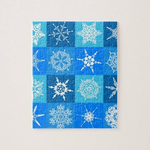 Copos de nieve blancos en cajas azules rompecabezas con fotos