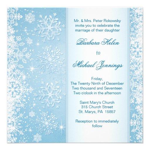 Copos de nieve blancos en la invitación azul del b
