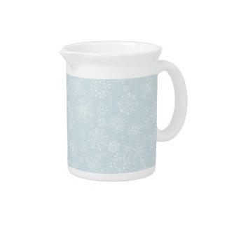 Copos de nieve congelados bosquejo retro en azules jarra