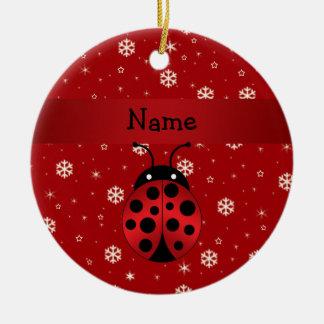 Copos de nieve conocidos personalizados del rojo adorno navideño redondo de cerámica
