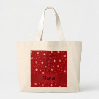 Copos de nieve conocidos personalizados del rojo d bolsas de mano