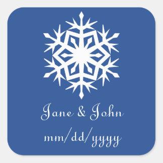 Copos de nieve del invierno en pegatina azul