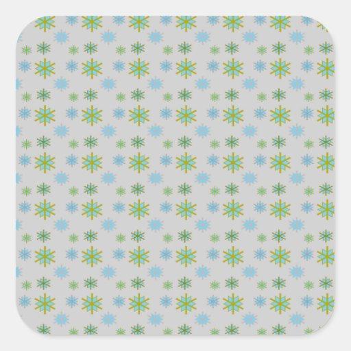 Copos de nieve del verde azul en la plata pegatina cuadrada