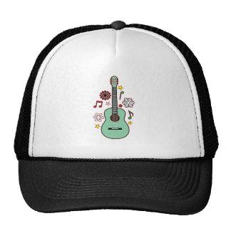 Copos de nieve del wirh de la guitarra y notas gorras