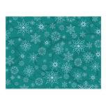 Copos de nieve en azul del invierno postal