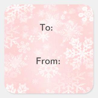 Copos de nieve en etiquetas rosadas del regalo pegatina cuadrada