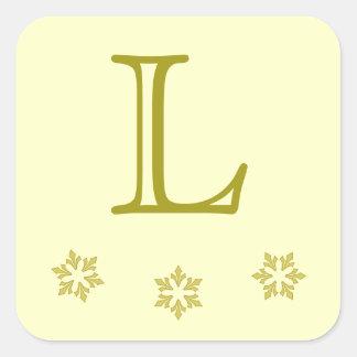 """""""Copos de nieve en oro"""" con el monograma [a] Pegatina Cuadrada"""