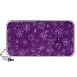 Copos de nieve en púrpura laptop altavoces