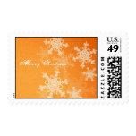 Copos de nieve femeninos del navidad anaranjado y