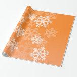 Copos de nieve lindos del navidad anaranjado y bla
