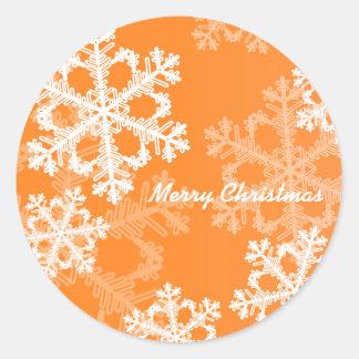 Copos de nieve lindos del navidad anaranjado y pegatina redonda