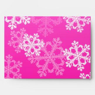 Copos de nieve lindos del navidad rosado y blanco