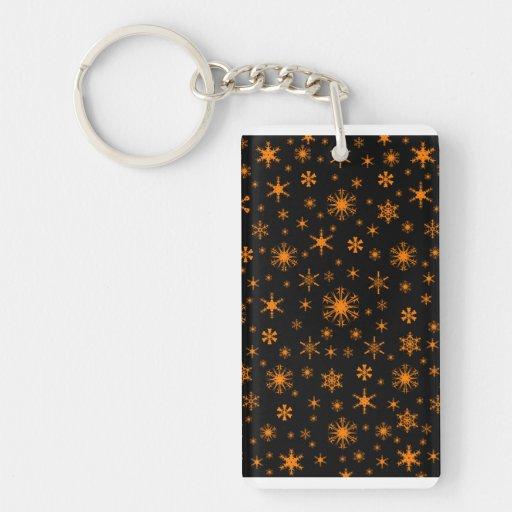 Copos de nieve - naranja en negro llavero
