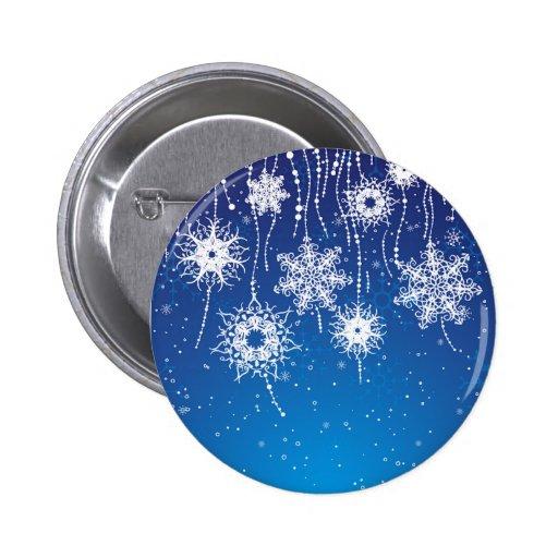 Copos de nieve que cuelgan chispeantes en azul pins