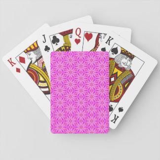 Copos de nieve rosados que hacen girar en invierno baraja de póquer