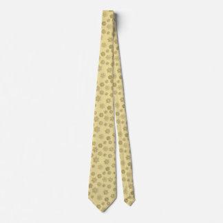 Copos de nieve tridimensionales de oro en un fondo corbata