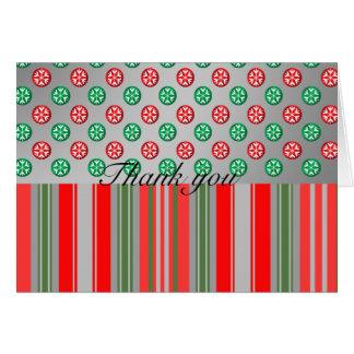 Copos de nieve verdes rojos en círculos en las ray tarjeta de felicitación