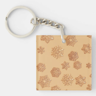 Copper 3-d snowflakes on a copper background keychain