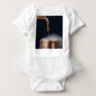 copper pipe of a distillery with steam. baby bodysuit